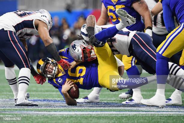 Trey Flowers and Dont'a Hightower of the New England Patriots sack Jared Goff of the Los Angeles Rams in the first half during Super Bowl LIII at...