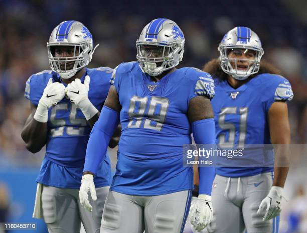 Trey Flowers Eric Lee and Jahlani Tavai of the Detroit Lions line up during the preseason game against the New England Patriots at Ford Field on...