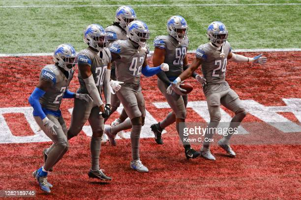 Trey Flowers of the Detroit Lions celebrates a fumble recovery with his teammates during the second half against the Atlanta Falcons at Mercedes-Benz...