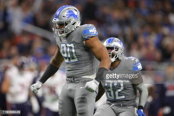 Trey Flowers of the Detroit Lions celebrates a second half sack with Tavon Wilson while playing the Chicago Bears at Ford Field on November 28, 2019...