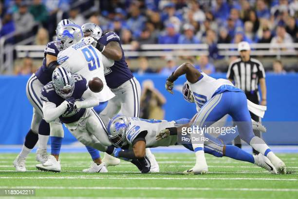 Trey Flowers of the Detroit Lions knocks the ball from Ezekiel Elliott of the Dallas Cowboys in the first quarter at Ford Field on November 17, 2019...