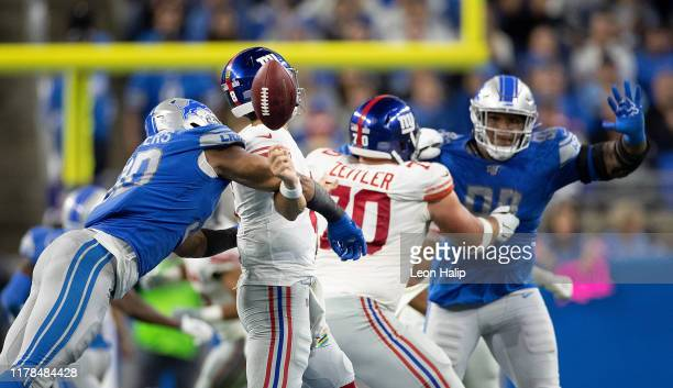Trey Flowers of the Detroit Lions sacks Daniel Jones of the New York Giants during the fourth quarter of the game at Ford Field on October 27, 2019...