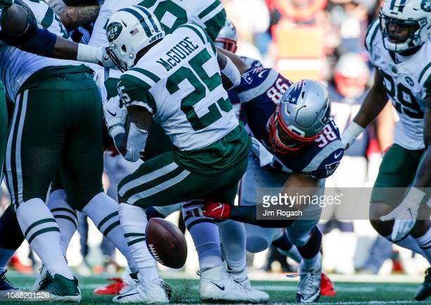 Trey Flowers of the New England Patriots forces a fumble out of the hands of Elijah McGuire of the New York Jets during the second quarter of a game...