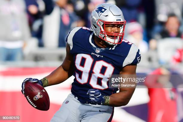 Trey Flowers of the New England Patriots reacts during a game against the Miami Dolphins at Gillette Stadium on November 26 2017 in Foxboro...