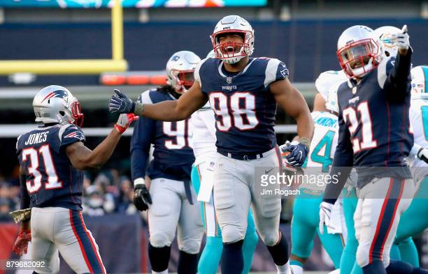 Trey Flowers of the New England Patriots reacts during the fourth quarter of a game against the Miami Dolphins at Gillette Stadium on November 26...