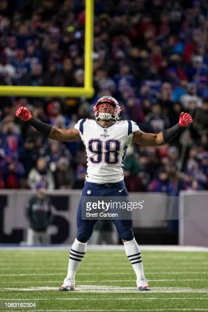 Trey Flowers of the New England Patriots reacts to a missed interception during the first quarter against the Buffalo Bills at New Era Field on...