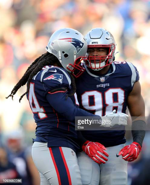 Trey Flowers of the New England Patriots reacts with Adrian Clayborn during the second quarter in the AFC Divisional Playoff Game against the Los...