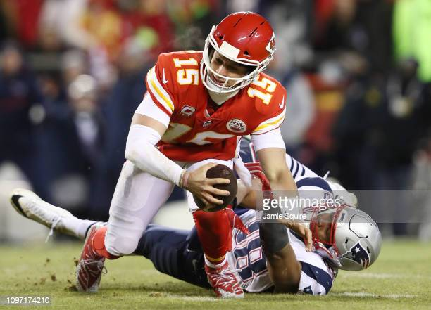 Trey Flowers of the New England Patriots sacks Patrick Mahomes of the Kansas City Chiefs in the first half during the AFC Championship Game at...
