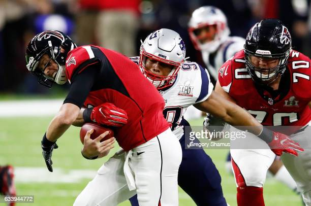 Trey Flowers of the New England Patriots tackles Matt Ryan of the Atlanta Falcons in the first quarter during Super Bowl 51 at NRG Stadium on...