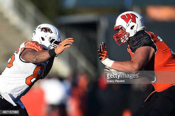 Trey Flowers of the South team works against Rob Havenstein of the North team during the Reese's Senior Bowl at Ladd Peebles Stadium on January 24,...
