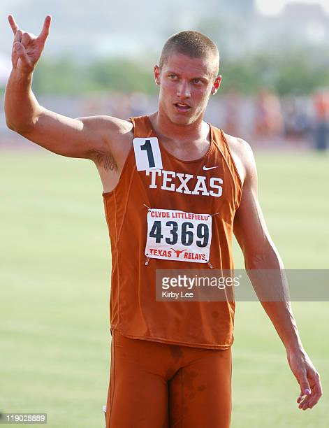 Trey Hardee of Texas flashes the Hook 'Em Horns symbol after setting a collegiate record of 8465 points to win the decathlon in the 79th Clyde...