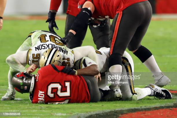 Trey Hendrickson and Cameron Jordan of the New Orleans Saints sack Tom Brady of the Tampa Bay Buccaneers during the third quarter at Raymond James...
