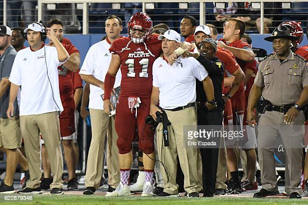 Trey Hendrickson of the Florida Atlantic Owls hugs Head Coach Charlie Partridge after they defeated the UTEP Miners at FAU Stadium on November 12...