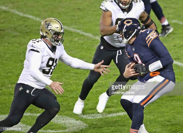 Trey Hendrickson of the New Orleans Saints moves to sack Nick Foles of the Chicago Bears at Soldier Field on November 01, 2020 in Chicago, Illinois....