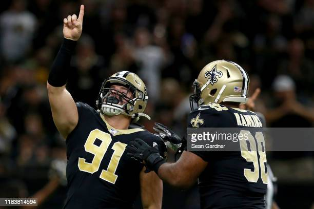 Trey Hendrickson of the New Orleans Saints reacts after a sack during a NFL game against the Arizona Cardinals at the Mercedes Benz Superdome on...