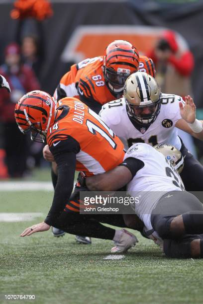 Trey Hendrickson of the New Orleans Saints sacks Andy Dalton of the Cincinnati Bengals during their game at Paul Brown Stadium on November 11 2018 in...
