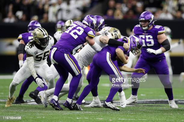 Trey Hendrickson of the New Orleans Saints sacks Kirk Cousins of the Minnesota Vikings during the first half in the NFC Wild Card Playoff game at...