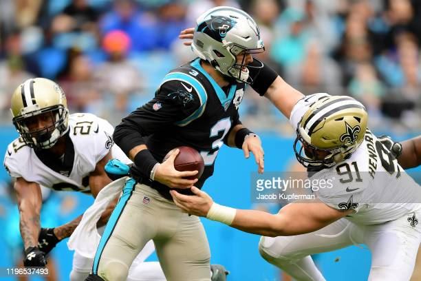 Trey Hendrickson of the New Orleans Saints tries to sack Will Grier of the Carolina Panthers during the second quarter during their game at Bank of...