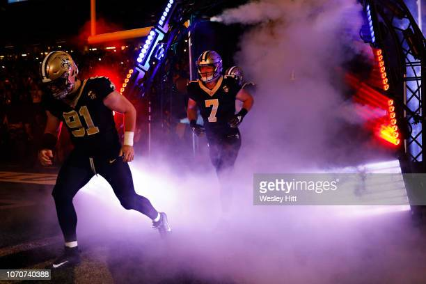 Trey Hendrickson Tayson Hill of the New Orleans Saints run out of the tunnel before a game against the Los Angeles Rams at MercedesBenz Superdome on...