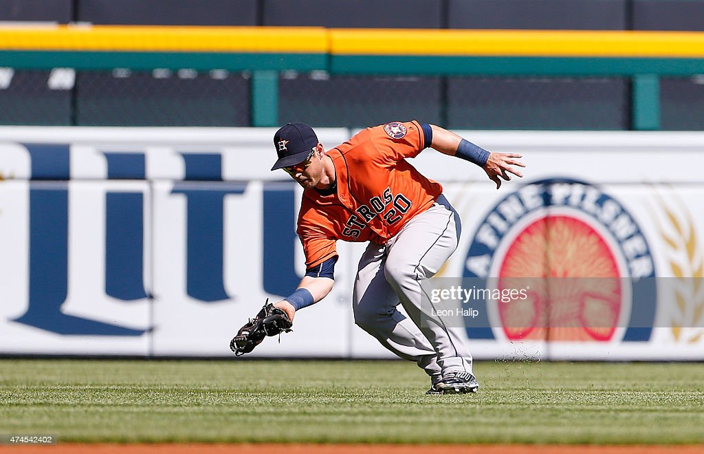 Trey Hillman #22 of the Houston Astros makes the catch on the line drive off the bat of Tyler Collins #18 of the Detroit Tigers (not in photo) during the fifth inning of the game on May 23, 2015 at Comerica Park in Detroit, Michigan. The Astros defeated the Tigers 3-2.