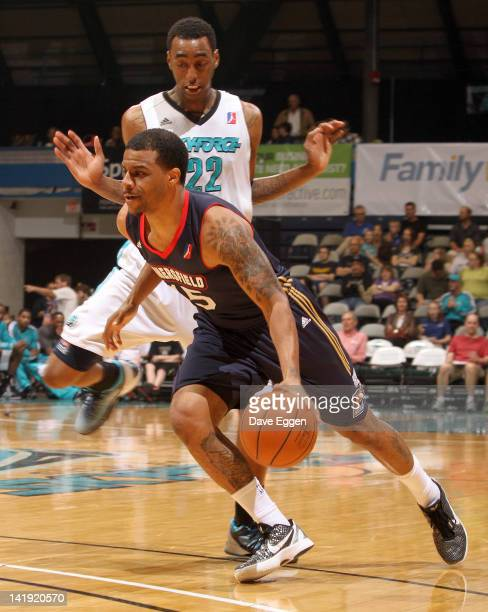 Trey Johnson from the Bakersfield Jam drives as Anthony Mason from the Sioux Falls Skyforce tries not to collide with Johnson in the first half of...