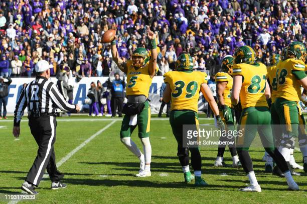 Trey Lance of the North Dakota State Bison celebrates in the closing seconds of the game to defeat the James Madison Dukes during the Division I FCS...