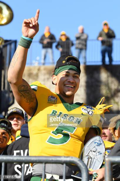 Trey Lance of the North Dakota State Bison celebrates their victory over the James Madison Dukes during the Division I FCS Football Championship held...