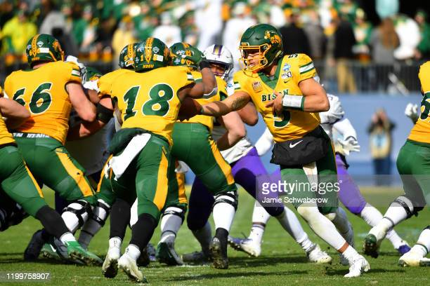 Trey Lance of the North Dakota State Bison hands off to Adam Cofield against the James Madison Dukes during the Division I FCS Football Championship...