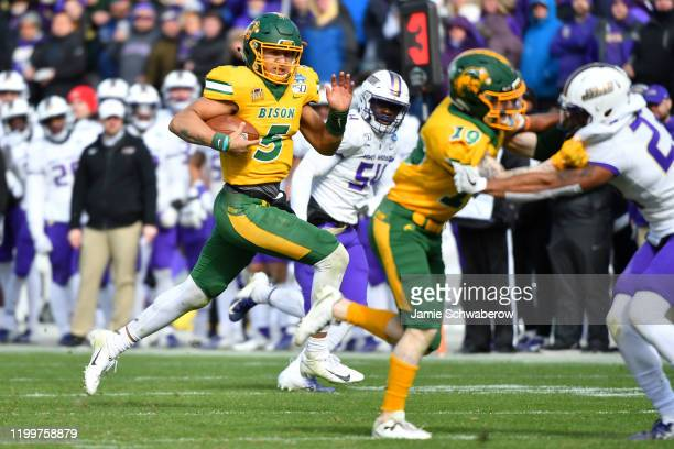 Trey Lance of the North Dakota State Bison runs the ball against the James Madison Dukes during the Division I FCS Football Championship held at...