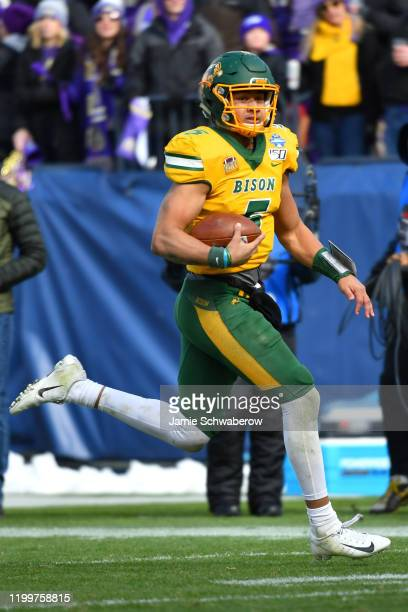 Trey Lance of the North Dakota State Bison rushes for a touchdown against the James Madison Dukes during the Division I FCS Football Championship...