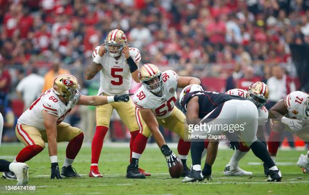 Trey Lance of the San Francisco 49ers checks down during the game against the Arizona Cardinals at State Farm Stadium on October 10, 2021 in...