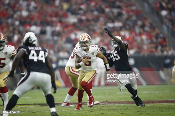 Trey Lance of the San Francisco 49ers rushes during the game against the Arizona Cardinals at State Farm Stadium on October 10, 2021 in Glendale,...