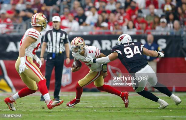 Trey Lance of the San Francisco 49ers scrambles during the game against the Arizona Cardinals at State Farm Stadium on October 10, 2021 in Glendale,...