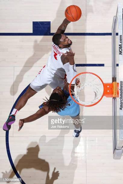 Trey Landers of the Dayton Flyers drives to the basket against Jermaine Harris of the Rhode Island Rams in the first half of a game at UD Arena on...