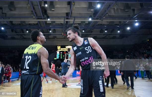 Trey Lewis of medi bayreuth shakes hands with Assem Marei of medi bayreuth during the easyCredit BBL match between medi bayreuth and FC Bayern...