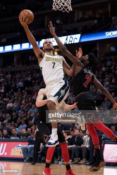 Trey Lyles of the Denver Nuggets drives against Justin Holiday of the Chicago Bulls at Pepsi Center on November 30 2017 in Denver Colorado NOTE TO...