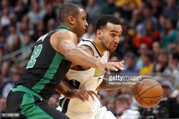 Trey Lyles of the Denver Nuggets drives to the basket against Al Horford of the Boston Celtics at the Pepsi Center on January 29 2018 in Denver...