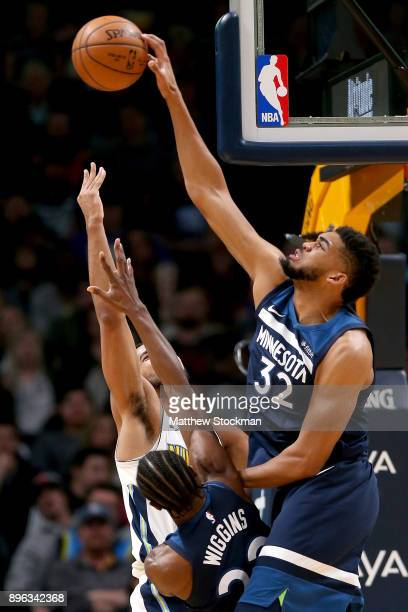 Trey Lyles of the Denver Nuggets is blocked driving to the basket by Andrew Wiggins and KarlAnthony Towns the Minnesota Timberwolves at the Pepsi...
