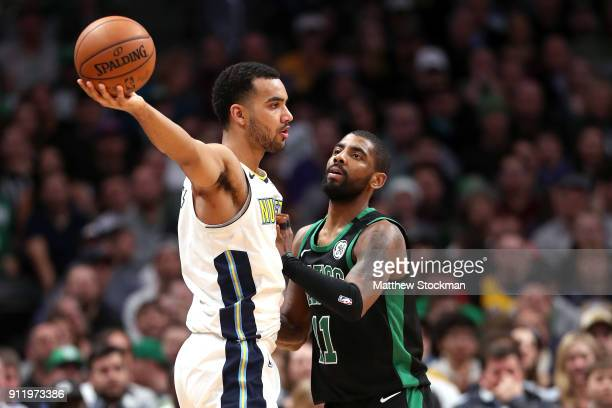Trey Lyles of the Denver Nuggets is guarded by Kyrie Irving of the Boston Celtics at the Pepsi Center on January 29 2018 in Denver Colorado NOTE TO...