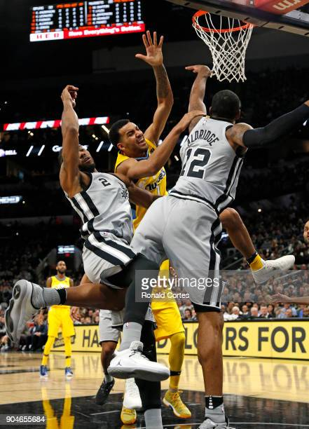 Trey Lyles of the Denver Nuggets is stopped by Kawhi Leonard of the San Antonio Spurs and LaMarcus Aldridge of the San Antonio Spurs at ATT Center on...