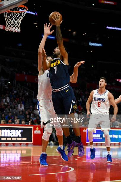 Trey Lyles of the Denver Nuggets plays against Boban Marjanovic of the Los Angeles Clippers on October 9 2018 at STAPLES Center in Los Angeles...