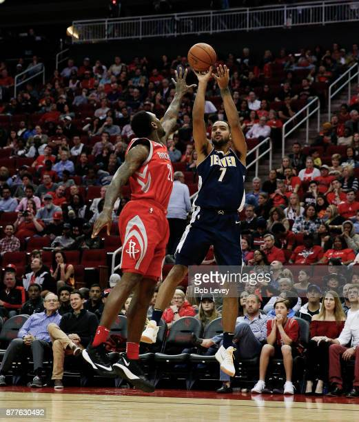 Trey Lyles of the Denver Nuggets shoots a fade over Tarik Black of the Houston Rockets at Toyota Center on November 22 2017 in Houston Texas NOTE TO...