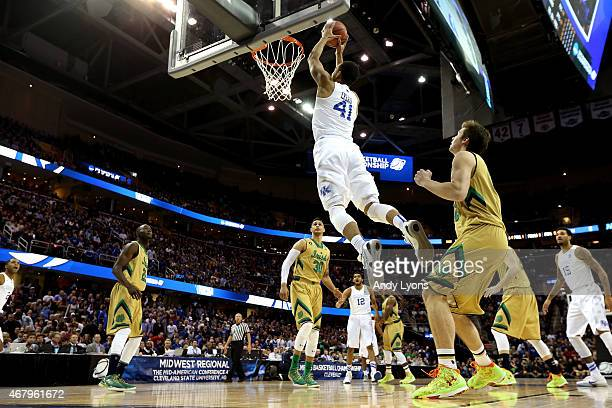 Trey Lyles of the Kentucky Wildcats goes up for a dunk in the first half against the Notre Dame Fighting Irish during the Midwest Regional Final of...