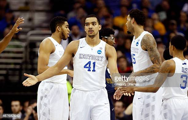 Trey Lyles of the Kentucky Wildcats reacts with teammates after a play in the first half against the West Virginia Mountaineers during the Midwest...