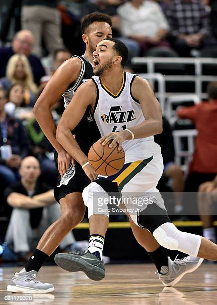 Trey Lyles of the Utah Jazz drives around the defense of Kyle Anderson of the San Antonio Spurs in the second half of the Spurs 10086 win at Vivint...