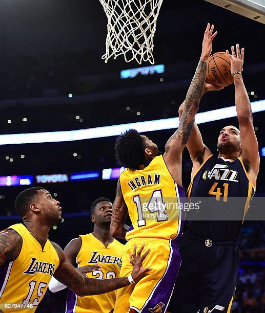 Trey Lyles of the Utah Jazz shoots over Brandon Ingram of the Los Angeles Lakers as Thomas Robinson and Julius Randle look on during the second half...