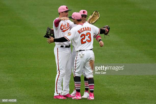 Trey Mancini Craig Gentry and Joey Rickard of the Baltimore Orioles celebrate following the Orioles 171 win over the Tampa Bay Rays at Oriole Park at...