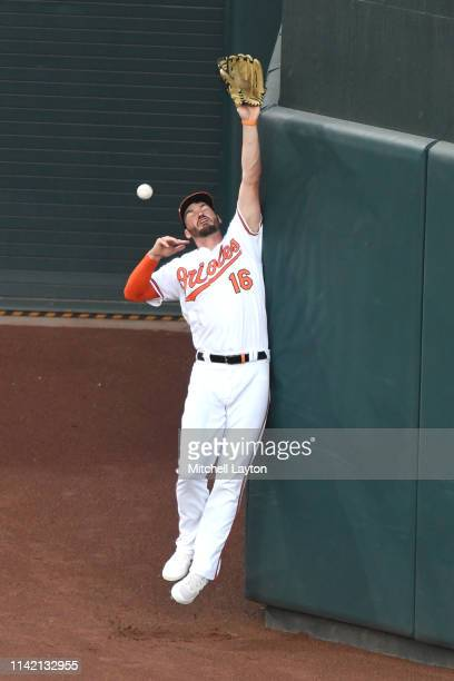 Trey Mancini of the Baltimore Orioles can catch a ball off the bat of Christian Vazquez of the Boston Red Sox in the second inning against the Boston...