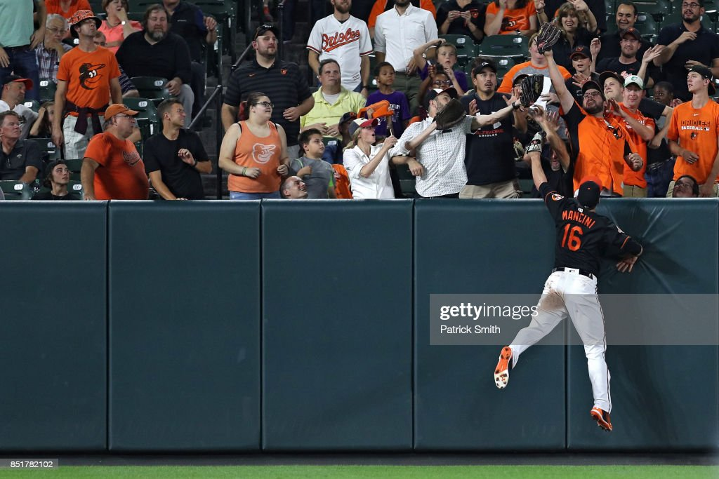 Trey Mancini #16 of the Baltimore Orioles cannot make a catch on a home run hit by Evan Longoria #3 of the Tampa Bay Rays (not pictured) during the third inning at Oriole Park at Camden Yards on September 22, 2017 in Baltimore, Maryland.