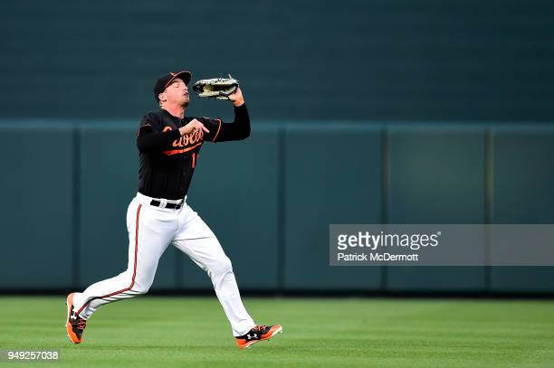 Trey Mancini of the Baltimore Orioles catches a fly ball hit by Yonder Alonso of the Cleveland Indians in the first inning at Oriole Park at Camden...